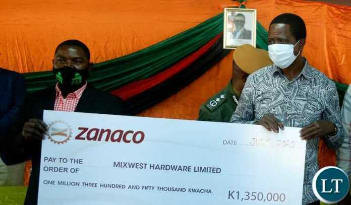 President Edgar Chagwa Lungu hands over a Grant Cheque to Mukelebai Mulonda of Mixwest Hardware Limited in Lukulu district, Western Province