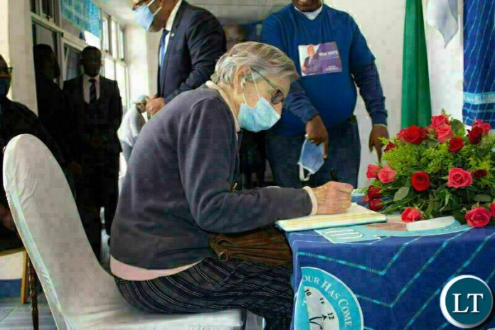 Mrs. Cynia Zukas signs in the MMD 30 year Commemoration book at Democracy House.