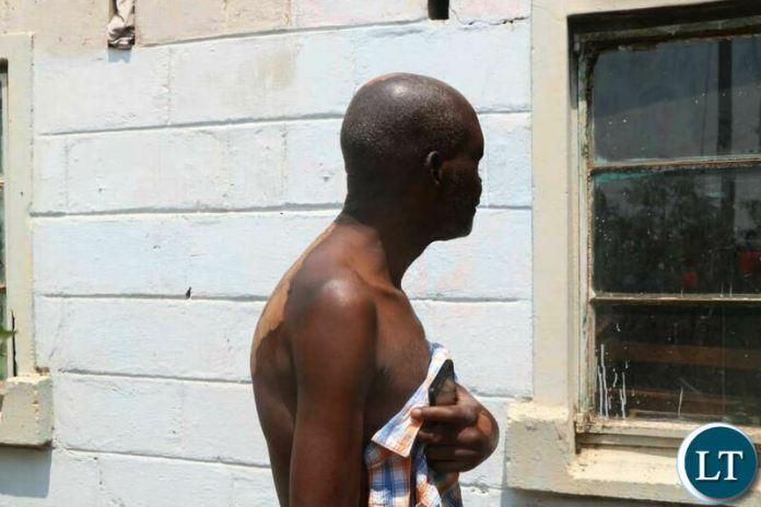UPND Muchinga ward 24 Trustee Peter Kalyata outside his Petrol Bombed House