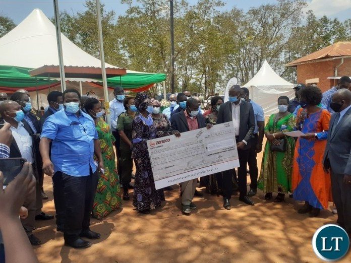 Vice-President Inonge Mutukwa Wina and Minister of National Development Planning Alexander Chiteme hand over Zambia Integrated Forest Landscape Projects grants cheques to Sinda Member of Parliament Masauso Phiri and some of his constituents in Chapata on 17 October 2020. PHOTO | MNDP