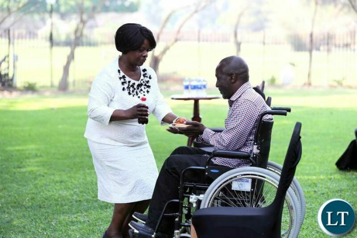 First Lady Esther Lungu serves Mr Shadrick Kankwala at State House where she donated a wheelchair to him on Tuesday, October 6,2020- Pictures by Eddie Mwanaleza/State house 06-10-2020