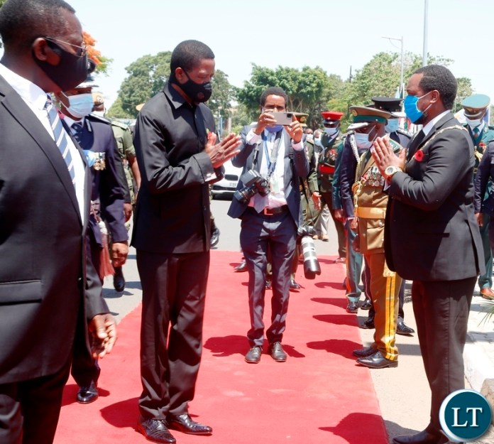 President Edgar Lungu greets Lusaka Mayor Miles Sampa during the remembrance day at the National Cenotaph in Lusaka.Picture by SUNDAY BWALYA/ZANIS