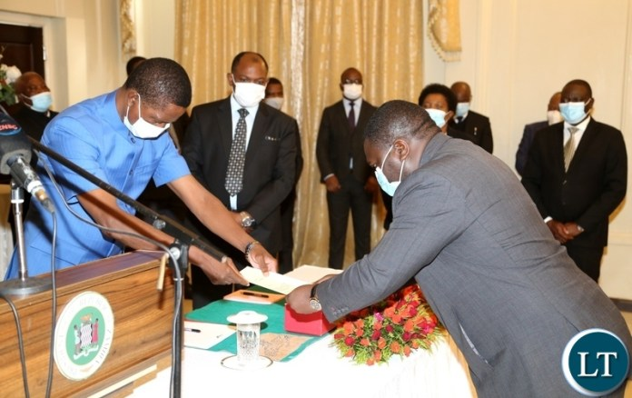 President Edgar Lungu receive the latter of Oath from the newly appointed Minister of Water Development Raphael Nakachinda during swearing in ceremony at State House. Monday, January 11, 2020. Picture by ROYD SIBAJENE/ZANIS