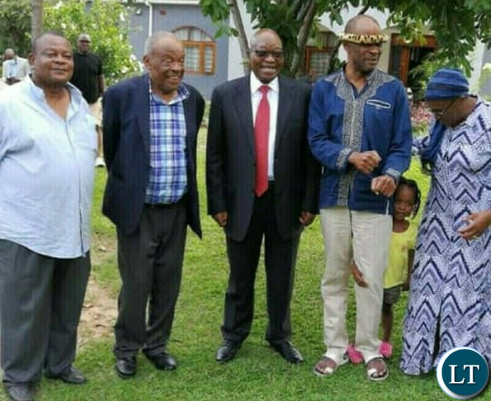 Former South African President Jacob Zumba with the the Mvunga family at Bank of Zambia Governor Christopher Mvunga's farm estate near Chongwe.