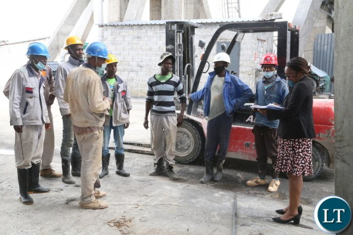 Ministry of Labour Principal Labour Officer Joseph Kaindama confers with workers without proper working suit at Anshan Investment Zambia Limited durning the inspection of the how the company is keeping the workers if it according to the labour laws. Yesterday, Wednesday January 10, 2021. Picture by ROYD SIBAJENE/ZANIS