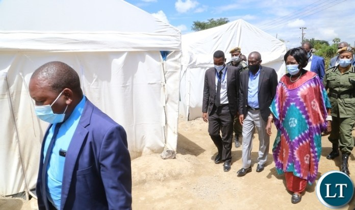 Vice President Inonge Wina with her entourage visiting the place where they relocated Kuku compound flood Victims to the up land near Kafue road