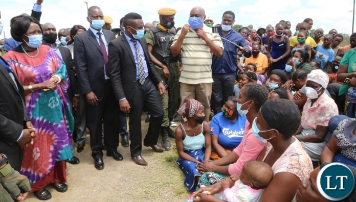Vice President Inonge Wina interacts with Kuku Compound flood victims relocated to the up land near Kafue road