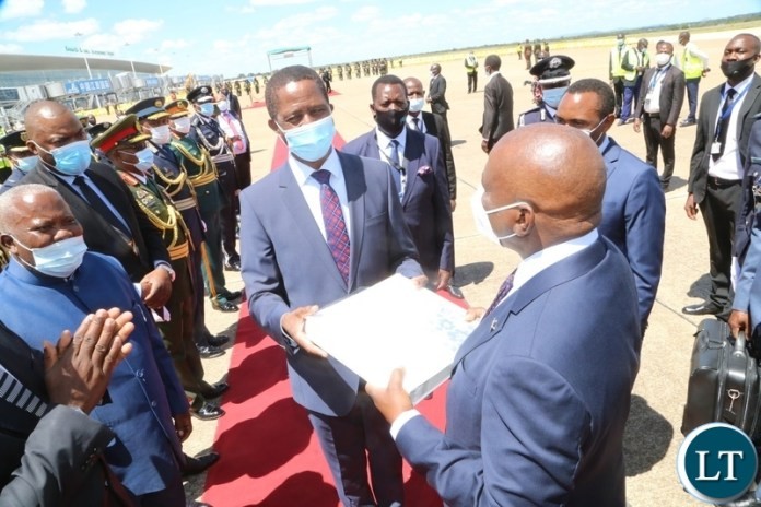 President Edgar Lungu hands over the presidential  photo album of his visit to his Botswana counterpart  Dr. Mokgweesti Eric Masisi at Kenneth Kaunda International airport before departure to Botswana yesterday, Wednesday, March 31, 2021. Picture by ROYD SIBAJENE/ZANIS