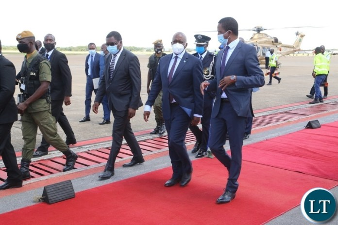 President Edgar Lungu confers with his Botswana counterpart  Dr. Mokgweesti Eric Masisi shortly before his departure to Botswana at Kenneth Kaunda International airport yesterday, Wednesday, March 31, 2021. Picture by ROYD SIBAJENE/ZANIS