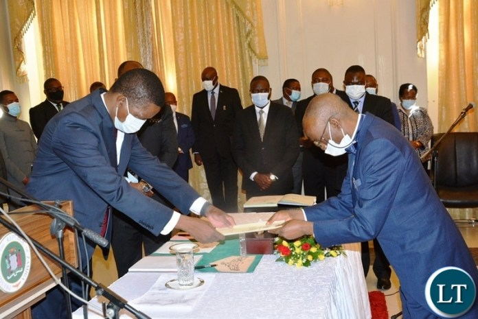 Justice Mwila Chitabo handing in his affidavit of oath to President Lungu when he was sworn in as Constitutional Court Judge at State House