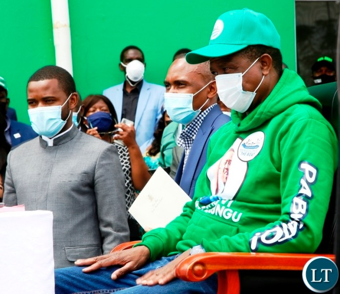 President Edgar Lungu (right) waits patiently for his nomination papers to be verified by PF Secretary General Davies Mwila during the filling in of nominations at the PF Secretariat. Picture by SUNDAY BWALYA/ZANIS