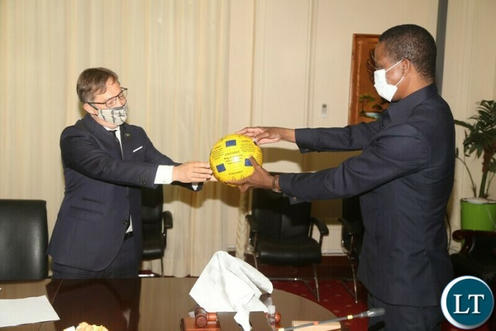 President Edgar Lungu receives a ball with covid-19 message from European Union Ambassador Mr.Jacek Jankowski at State House