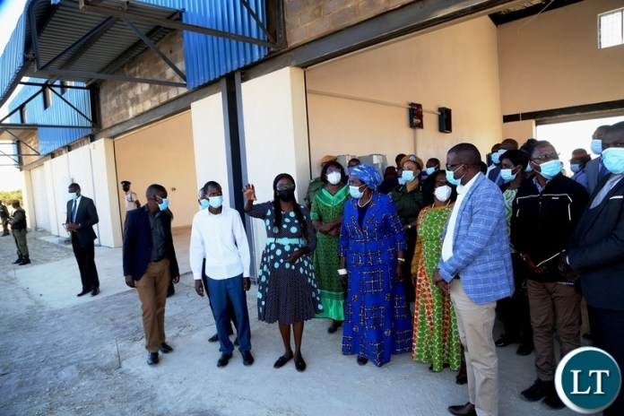 Western Province CEEC manager Maureen Makwembo explains on the progress of the Vice President Inonge Wina and her encourage listens during the tour of the industrial yard in Mongu yesterday. Thursday, May 27, 2021. Picture by ROYD SIBAJENE/ZANIS