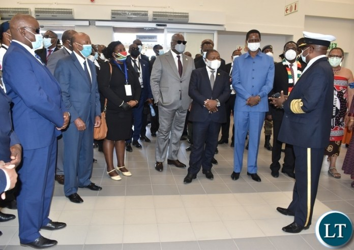 Director General of Immigration Dr Denny Lungu briefing the visiting Heads of State on the newly opened Passenger terminal at Kazungula one stop border post