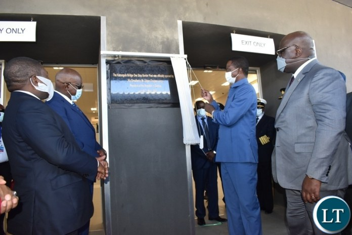 President Edgar Lungu unveils the plaque at Kazungula bridge one stop border post on the Zambian side whilst other Heads of state look on