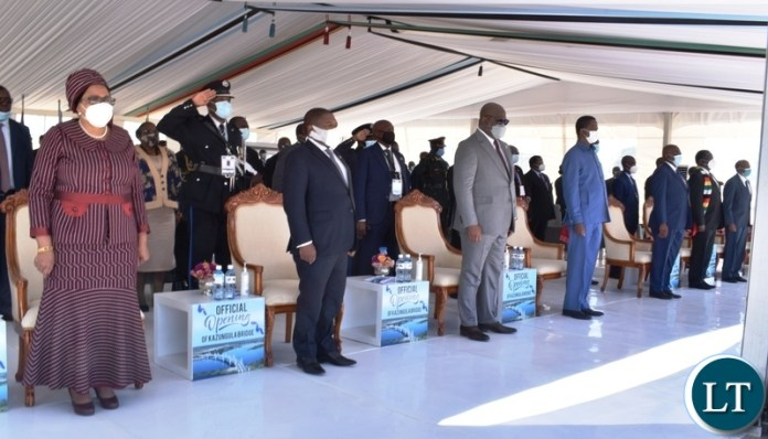 Presidents stand as national anthems are being played during the offcial opening of Kazungula bridge