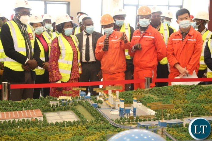 Mr.Paikani Banda shows the Vice President Inonge Wina and her entourage the map of the Sinoma Cement factory during the tour of the Sinoma Cement in Chongwe District yesterday. Tuesday, June 8, 2021. Picture by ROYD SIBAJENE ZANIS