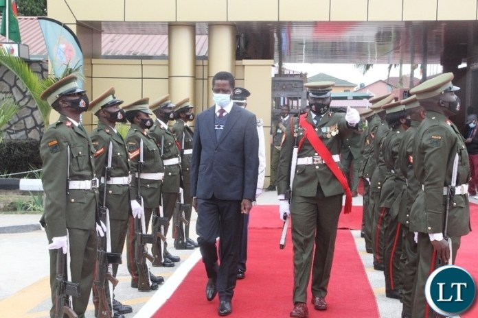 President Edgar Lungu inspects the quarter guard during the silver jubilee celebration and official launch of the new staff college and National Defence University in Lusaka.
