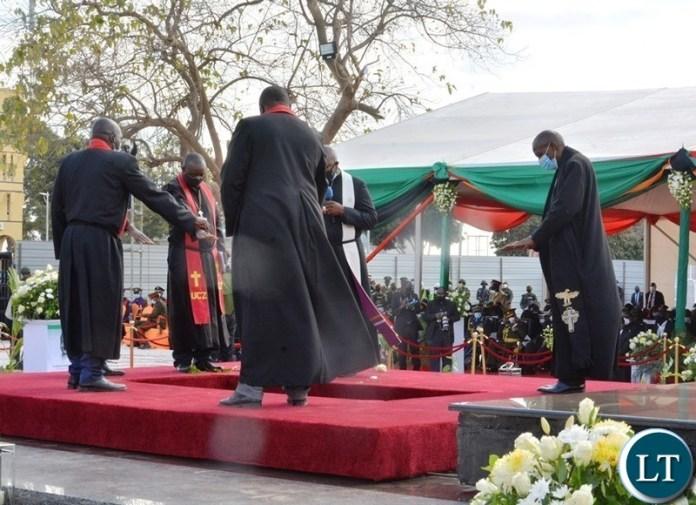 Clergymen blessing the grave of the late President Dr Kenneth Kaunda