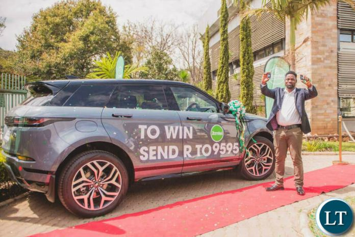 Kelvin Bandela, winner of the Win a Range Rover promotion poses in front of his new car