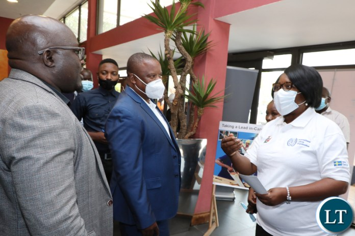 Minister of Labour Brenda Tambatamba (R) talks to FFTUZ Secretary General Victor Muyumba (L) as FFTUZ president Chingati Msiska (C) looks on during the official Launch of the World Day for Decent Work at Pamodzi Hotel in Lusaka on Wednesday, October 6,2021- Picture by THOMAS NSAMA/ ZANIS