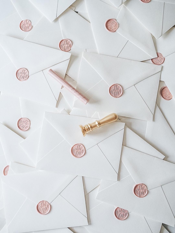 Blush wax seal wedding invitations