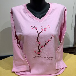 Cherry Pink tee with a cherry tree in bloom. Women's pink tee with vee neck and 3/4 sleeve.