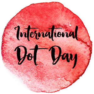 Orange watercolor dot with text that reads International Dot Day