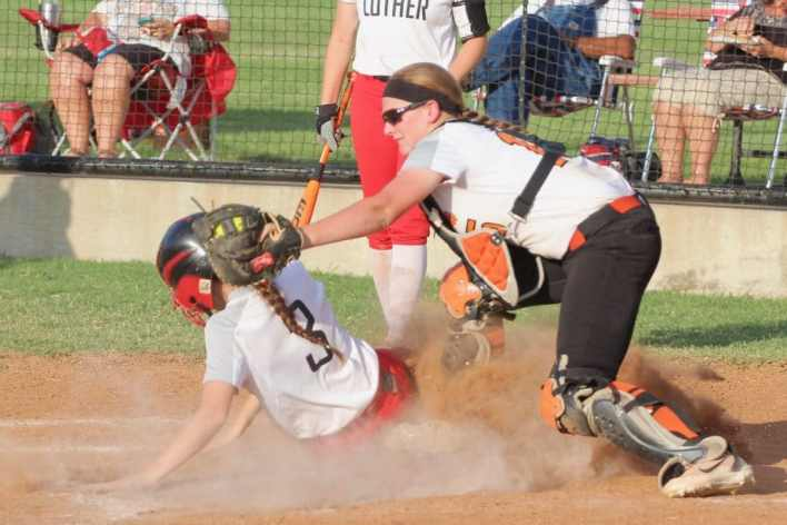 Luther softball, safe at home