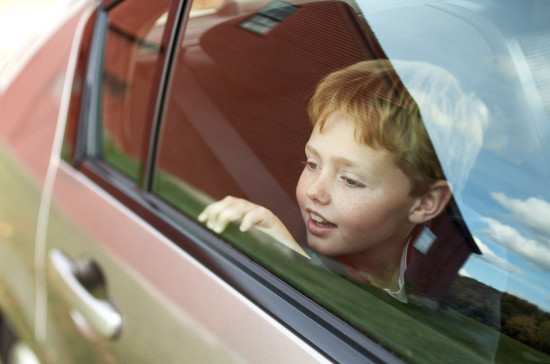 Redheaded Boy Looking out of Car Window
