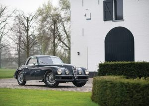 photo of a 1948 Alfa Romeo 6C 2500 Super Sport Coupe by Touring Car on the driveway newt to house