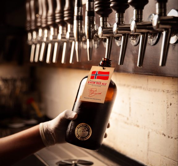 Filling a growler with beer at Gateway Brewing Co.