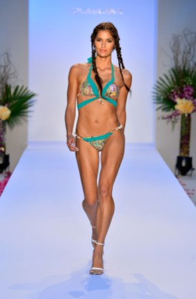 A model walks the runway at the Aqua Di Lara show during Mercedes-Benz Fashion Week Swim 2014 at Oasis at the Raleigh on July 20, 2013 in Miami, Florida.