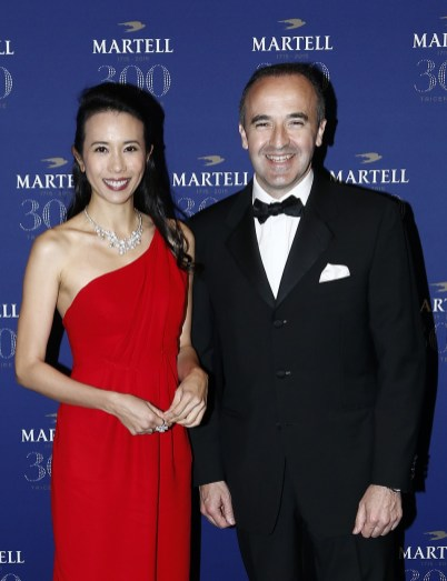 VERSAILLES, FRANCE - MAY 20: Actress and singer Karen Mok (L) and Philippe Guettat, Martell CEO and Chairman, are pictured arriving at Martell Cognac's 300th anniversary event at the iconic Palace of Versailles on May 20, 2015 in Versailles, France. (Photo by Julien M. Hekimian/Getty Images for Martell Cognac)