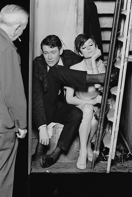 Actors Peter O'Toole and Audrey Hepburn (1929 - 1993) get uncomfortable together in a cramped broom cupboard, in a scene from the crime caper 'How to Steal a Million', 1966.