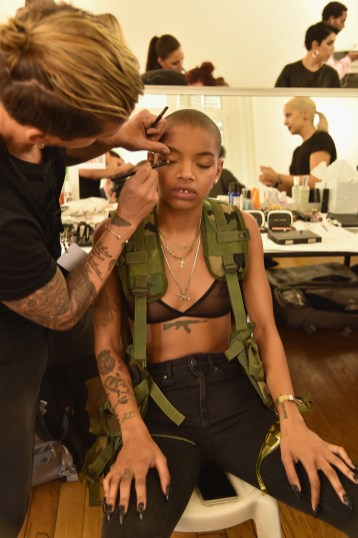 PARIS, FRANCE - SEPTEMBER 28: A model has makeup applied backstage during FENTY x PUMA by Rihanna at Hotel Salomon de Rothschild on September 28, 2016 in Paris, France. (Photo by Pascal Le Segretain/Getty Images for Fenty x Puma)