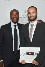 HOLLYWOOD, CA - NOVEMBER 15: Actor/presenter Don Cheadle (L) and honoree Andrew Bastawrous pose with award at the 2016 Rolex Awards for Enterprise at the Dolby Theatre on November 15, 2016 in Hollywood, California. (Photo by Emma McIntyre/Getty Images for Rolex Awards for Enterprise )