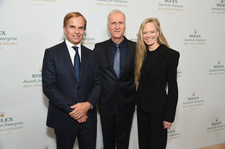 HOLLYWOOD, CA - NOVEMBER 15: (L-R) CEO of Rolex Jean-Frederic Dufour, filmmaker James Cameron and actress Suzy Amis Cameron attend the 2016 Rolex Awards For Enterprise at the Dolby Theatre on November 15, 2016 in Hollywood, California. (Photo by Michael Kovac/Getty Images for Rolex Awards for Enterprise )