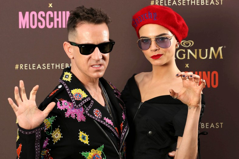 EDITORIAL USE ONLY Cara Delevingne and Jeremy Scott, Moschino Creative Director, arrive at a launch party to unveil the Magnum x Moschino bag capsule collection in celebration of Magnum Double ice cream in Cannes, France. PRESS ASSOCIATION Photo. Picture date: Thursday May 18, 2017. Photo credit should read: David Parry/PA Wire