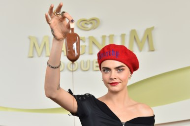 EDITORIAL USE ONLY Cara Delevingne makes her own personalised Magnum at the Magnum x Moschino launch event in Cannes, France. PRESS ASSOCIATION Photo. Picture date: Thursday May 18, 2017. Photo credit should read: Matt Crossick/PA Wire