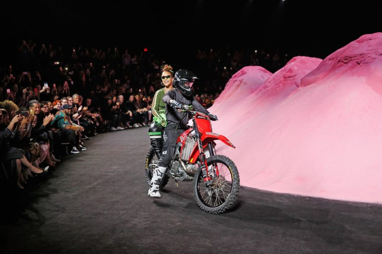 NEW YORK, NY - SEPTEMBER 10: Rihanna rides a dirtbike on the runway at the FENTY PUMA by Rihanna Spring/Summer 2018 Collection at Park Avenue Armory on September 10, 2017 in New York City. (Photo by Brian Ach/Getty Images for FENTY PUMA By Rihanna)