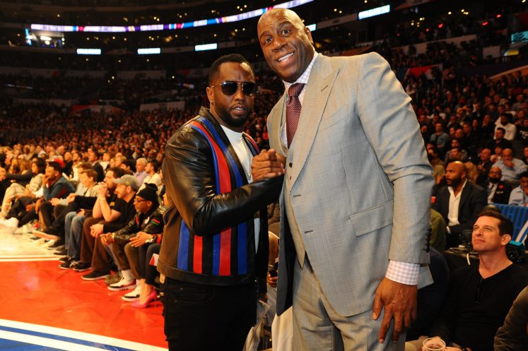 LOS ANGELES, CA - FEBRUARY 18: Magic Johnson and Diddy shake hands during the NBA All-Star Game as a part of 2018 NBA All-Star Weekend at STAPLES Center on February 18, 2018 in Los Angeles, California. NOTE TO USER: User expressly acknowledges and agrees that, by downloading and/or using this photograph, user is consenting to the terms and conditions of the Getty Images License Agreement. Mandatory Copyright Notice: Copyright 2018 NBAE (Photo by Juan Ocampo/NBAE via Getty Images)