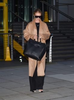 EXCLUSIVE: Rosie Huntington-Whiteley seen leaving M&S headquarters after meetings in London, England, UK. The British model sported a chic casual look in a tan winter coat, and hid her face with a pair of over sized sunglasses. Pictured: Rosie Huntington-Whiteley Ref: SPL1660532 170218 EXCLUSIVE Picture by: Flynet - Splash News Splash News and Pictures Los Angeles: 310-821-2666 New York: 212-619-2666 London: 870-934-2666 photodesk@splashnews.com