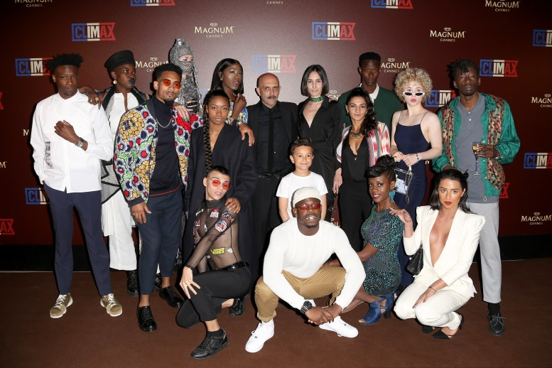 Director Gaspard Noe (black tie, in the center ) surrounded by the cast of actors and dancers of the film 'Climax' - Magnum VIP Party for the movie 'Climax' during the 71st annual Cannes Film Festival on May 13, 2018 in Cannes, France.