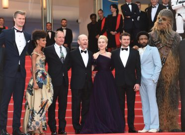 CANNES, FRANCE - MAY 15: (L-R) Producer Simon Emanuel, actor Joonas Suotamo, actress Thandie Newton, actor Woody Harrelson, director Ron Howard, actress Emilia Clarke, actor Alden Ehrenreich, actor Donald Glover and Chewbacca attend the European Premiere of 'Solo: A Star Wars Story' at Palais des Festivals on May 15, 2018 in Cannes, France. (Photo by Antony Jones/Getty Images for Disney) *** Local Caption *** Simon Emanuel;Joonas Suotamo;Thandie Newton;Woody Harrelson;Ron Howard;Emilia Clarke;Alden Ehrenreich;Donald Glover;Chewbacca