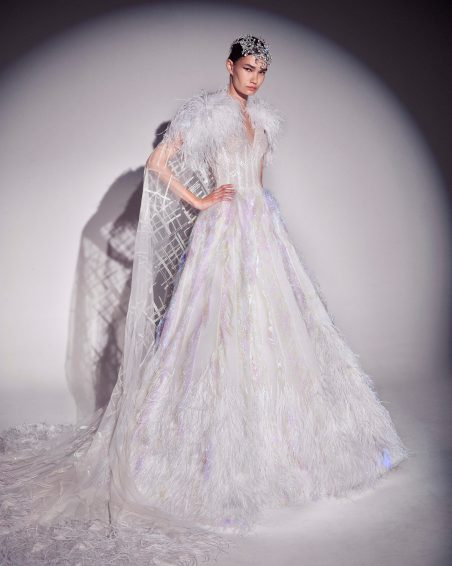 FW19-23 Iridescent Laser-Cut Fringed Wedding Gown Embellished With Crystals Featuring A Cape With Ostrich Feathers