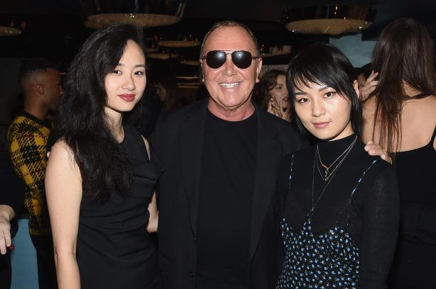 NEW YORK, NY - SEPTEMBER 12: Michael Kors (C) and Bibi Zhou (R) attend the Michael Kors x 10 Corso Como Dinner at 10 Corso Como on September 12, 2018 in New York City. (Photo by Larry Busacca/Getty Images for Michael Kors)