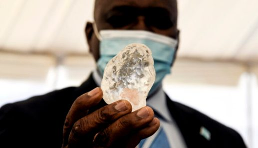 Botswana President Mokgweetsi Masisi (R) holds a gem diamond in Gaborone, Botswana, on June 16, 2021. Botswanan diamond firm Debswana said on June 16, 2021 it had unearthed a 1,098-carat stone that it described as the third largest of its kind in the world. The stone, found on June 1, 2021 was shown to President Mokgweetsi Masisi in the capital Gaborone.,Image: 615987016, License: Rights-managed, Restrictions: , Model Release: no, Credit line: Profimedia