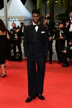 ALTON MASON IS DRESSED BY DIOR HE WORE A BLACK MOHAIR WOOL PEAK LAPEL OBLIQUE TUXEDO, WHITE SILK SHIRT, BLACK SILK BOW-TIE AND A PAIR OF BLACK LEATHER DERBIES WITH SADDLE DETAIL