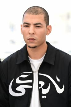 """CANNES, FRANCE - JULY 16: Anas Basbousi attends the """"Haut Et Fort (Casablanca Beats)"""" photocall during the 74th annual Cannes Film Festival on July 16, 2021 in Cannes, France. (Photo by Daniele Venturelli/WireImage) ANAS BASBOUSI IS MADE UP BY DIOR FOR THE FACE : DIORSKIN FOREVER SKIN CORRECT - WARM 4W FOR THE LIPS : ROUGE DIOR 2020 - 000 UNIVERSAL NEUTRAL"""
